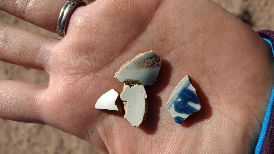 hand full of majolica ceramic fragments